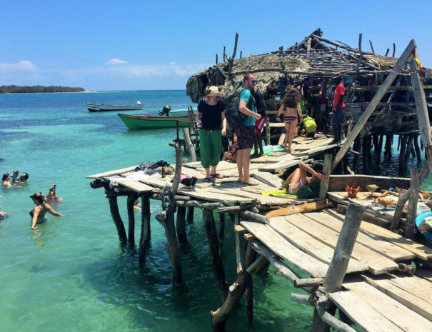 pelican bar people on pier and water